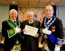 Bro. Les Duff R.W.M., in the company of our R.W.P.G.M. presents Bro. George Arbuckle M.M. with his jubilee diploma