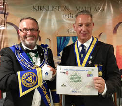 Bro. Craig Gordon presents a certificate to our Right Worshipful Master Bro. Gordon Yeoman to mark the contribution made by 482 to the recent Provincial Grand Lodge of Midlothian Charity Golf Tournament.